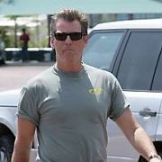 Irish Actor Pierce Brosnan looks like he's developing a beer-belly - spotted getting his Aston Martin detailed at the Malibu Car Wash, Malibu, USA. 27.05.06.