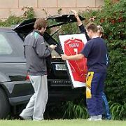 EXCLUSIVE ALLROUND: Westlife's Nicky Byrne shows his ex-band mate Brian McFadden, his wife Georgina and some friends a valuable framed genuine Kenny Dalglish No 7 Liverpool Jersey before their 5-a-side football match at Portmarnock Sport & Leisure Centre, Dublin, Ireland - 22.06.06.