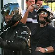 Bono of U2 Arrives on a taxi motorbike to Abbey Road studios where The Edge & Rick Ruben are signing autographs for their fans, London, England - 20.09.06.