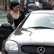 EXCLUSIVE: Andrea Corr gets into her SLK parked on double yellow lines with a mystery man outside the Merrion Hotel and Government Buildings, Dublin, Ireland April 05 2005.