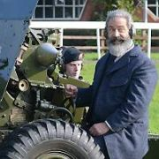 Still in period dress, Mel Gibson stops filming The Professor and The Madman on location at McKee Barracks, and jumps the fence to join-in with the Irish Defence Force 2 Brigade Artillery Regiment's 21 Gun Salute rehearsal where the Braveheart actor got to fire the 25 Pounder Field Gun which was loaded blank demo shells, Dublin, Ireland - 14.10.16. Pictures: VIPIRELAND.COM **IRISH RIGHTS ONLY**