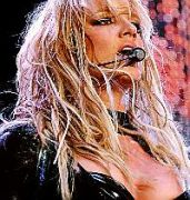 Britney Spears' left nipple pops out during a dance routine after one of her dancer's arm catches on her PVC top at the Odyssey Arena, Belfast, Northern Ireland June 1 2004.