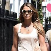 Vogue Williams seen filming her latest TV show for RTE at locations on South William Street including Tropical Popical. With two costume changes, at one point Vogue walked past a advertising poster featuring herself and also had to help a crew member to his feet, Dublin, Ireland - 18.07.17. Pictures: Cathal Burke / VIPIRELAND.COM **IRISH RIGHTS ONLY**