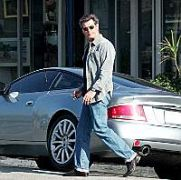 Pierce Brosnan picks up his son from school in style as he drives up in his silver Aston-Martin valued at 250,000 dollars. Malibu, Ca, USA 14.04.05.