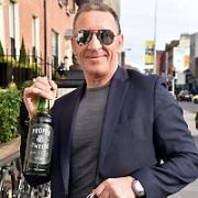 Conor McGregor's father Tony McGregor seen walking past The Shelbourne Hotel with a bottle of his son's Proper Twelve Whiskey, Dublin, Ireland - 13.03.19. Pictures: Cathal Burke / VIPIRELAND.COM **IRISH RIGHTS ONLY**