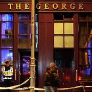 EXCLUSIVE ALLROUND: All is Quiet on New Years Day: A lone Garda stands outside closed pub The George after a Christmas tree fire on the premises at their New Years Eve Party, Georges St, Dublin, Ireland - 01.01.07.