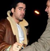 Colin Farrell leaves the Purty Kitchen Bar with some friends after enjoying some Christmas drinks. He grabbed at the two photographers who were following him and shouted