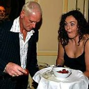 Gazza knocks a tray of drinks over his suit at Keith O'Neill's charity benefit dinner at The Burlington Hotel, Dublin, Ireland May 5 2005.