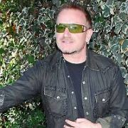 EXCLUSIVE ALLROUND: U2 frontman Bono signs autographs for waiting fans as he leaves his Hollywood hotel in a big black gas-guzzler, Los Angeles, California - 11.10.07.
