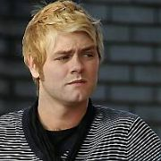 EXCLUSIVE ALLROUND: Irish singer and songwriter Brian McFadden returned from Australia with a new blonde hairstyle. Spotted filling up with fuel at a petrol station, it looks like the singer has packed on a few pounds, London, England - 23.10.07.
