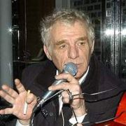 Eamon Dunphy sings on Grafton Street with a Busker Outside Lillies Bordello, Dublin, Ireland January 29 2005.