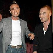Fran Cosgrave showed Ronan Keating & Dennis Taylor his funky dance moves at the launch of PigsBack.com at Cafe De Paris, London, England. 19.10.05.