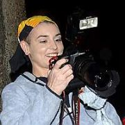 Irish singer Sinead O'Connor gets revenge on the Paparazzi by snapping them outside The Late Late Show Studios, Dublin, Ireland February 11 2005. Sinead announced she is making a comeback to the music industry on the show...