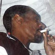 Snoop Dogg smokes a 'home-made cigarette' out a window at Spirit at an afterparty for The Meteor Ireland Music Awards 2005, Dublin, Ireland February 25 2005.